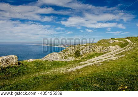 The Cliffs Of The Jurassic Coast On The Isle Of Portland, Portland, Dorset, Uk On A Hazy And Sunny S