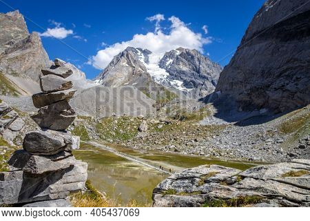 Cairn In Front Of The Cow Lake, Lac Des Vaches, In Vanoise National Park, French Alps