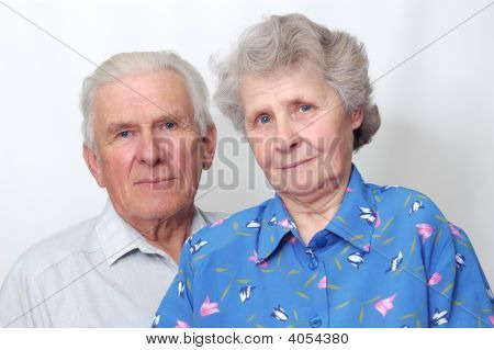 Happy Old Couple Looking To The Camera