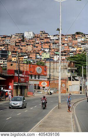 Vehicles Along Slum Dwellings