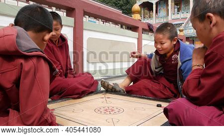Bhaktapur, Kathmandu, Nepal - 18 October 2018 Cheerful Young Boys Playing Table Game In Temple Yard.