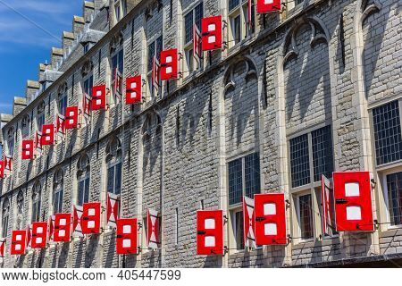 Red Shutters On The Wall Of The Historic Town Hall In Gouda