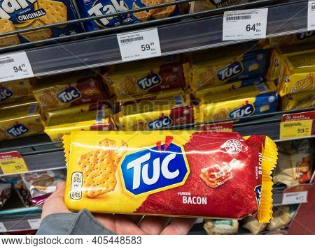 Belgrade, Serbia - January 19, 2021: Hands Holding A Pack Of Tuc Crackers. Tuc Is A Brand Of Cracker
