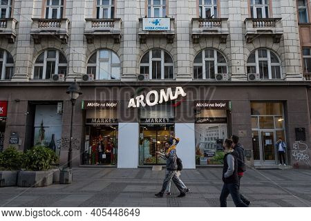 Belgrade, Serbia - May 12, 2020: People Passing By The Entrance Of An Aroma Market Supermarket With