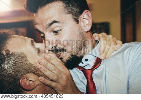 Loving Gay Couple Kissing Passionately At The Wedding Party - Two Handsome Men Having Romantic Kiss