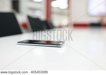 Mobile Touchscreen Phone Lying On Table In Office. Working With Gadgets Concept