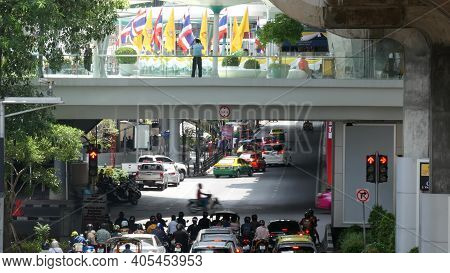 Bangkok, Thailand - 11 July, 2019: Intersection On Busy City Street. People On Motorcycles And Cars