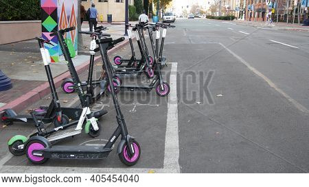 San Diego, California Usa - 4 Jan 2020: Row Of Ride Sharing Electric Scooters Parked On Street In Ga
