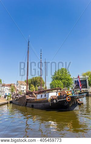 Gouda, Netherlands - May 21, 2020: Old Wooden Sailing Ship In The Historic Harbor Of Gouda, Netherla