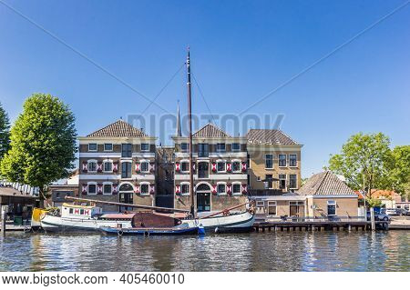 Gouda, Netherlands - May 21, 2020: Old Wooden Ship And Warehouses In The Harbor Of Gouda, Netherland