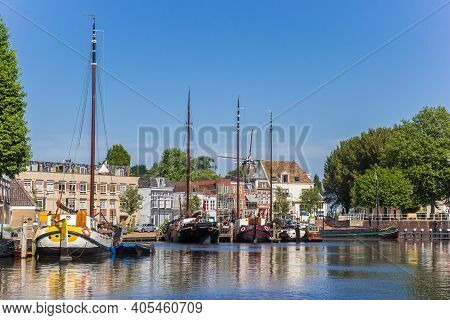 Gouda, Netherlands - May 21, 2020: Historic Ships And Old Houses In The Harbor Of Gouda, Netherlands