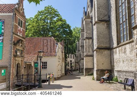 Gouda, Netherlands - May 21, 2020: Small Street Along The Side Of The Historic Sint Jan Church In Go