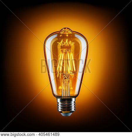 Vintage Led Light Bulb Against A Black Background