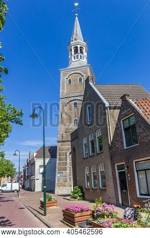 Gouda, Netherlands - May 21, 2020: Historic Vrouwentoren Tower And Houses In Gouda, Netherlands
