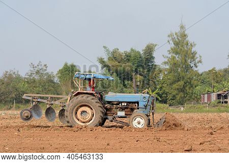 Close Up Tractor Plowing Groove In Field Thailand.