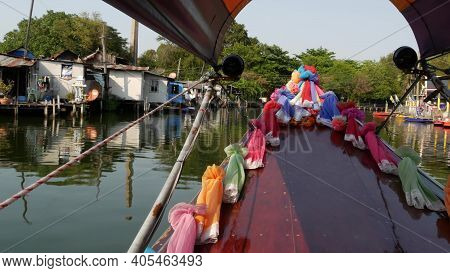 Tourist Trip On Asian Canal. View Of Calm Channel And Residential Houses From Decorated Traditional