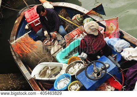 Tai O, Hong Kong - 25th February, 2015: People In Fishing Boat In Village. From Above Of Ethnic Fish