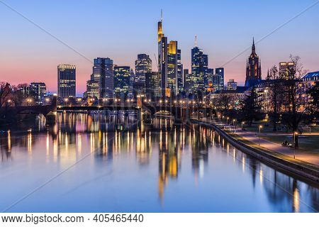 Frankfurt City Skyline In The Evening After Sunset. Illuminated Buildings Of High-rise Buildings Fro