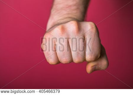Fist. Man Fists Clenched In Anger. Man Hands With Fist Gesture Front Side Isolated On Red  Backgroun