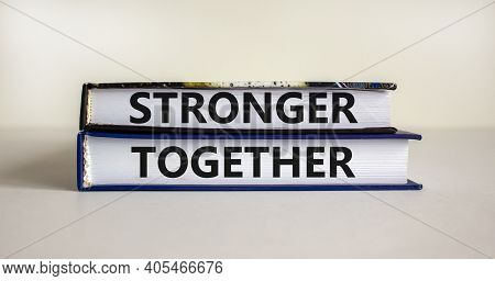 Stronger Together Symbol. Concept Words 'stronger Together' On Books On A Beautiful White Background
