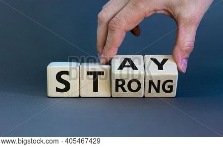 Stay Strong Symbol. Businessman Turns Cubes With Words 'stay Strong'. Beautiful Grey Background. Mot