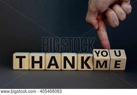 Thank You Or Me Symbol. Businessman Turns Cubes And Changes Words 'thank Me' To 'thank You'. Beautif