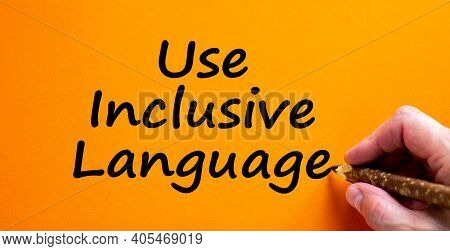 Use Inclusive Language Symbol. Hand Writing 'use Inclusive Language', Isolated On Orange Background.