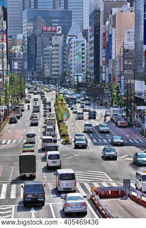 Tokyo, Japan - May 11, 2012: People Drive In Shinjuku District, Tokyo. Shinjuku Is One Of The Busies