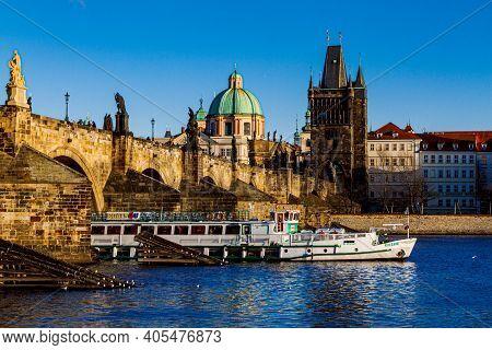 Prague, Czechia - 14 December 2017: Tourist Ships On The Vltava River On The Background Of Charles B
