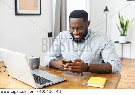 Smiling Young African American Hipster Business Man Professional Making Business, Looking On The Pho