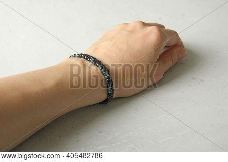 Black Opal Bracelet. A Bracelet Made Of Stones On A Hand From A Natural Stone Black Opal. Bracelet M