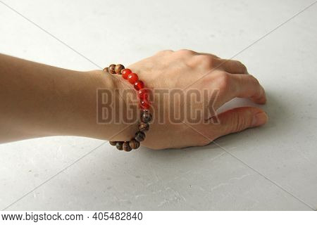 Bracelet Made Of Wooden Beads On A Woman's Hand, Bracelet Made Of Natural Stones, Natural Carnelian.