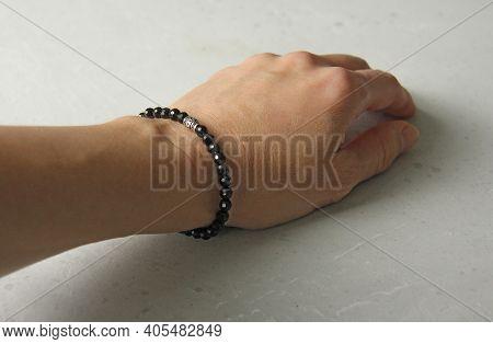 Black Spinel Bracelet. Bracelet Made Of Stones On Hand From Natural Stone Black Spinel With Cut. Bra