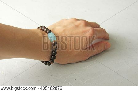 Bracelet Made Of Wooden Beads On A Woman's Hand, Bracelet Made Of Natural Stones, Natural Aquamarine