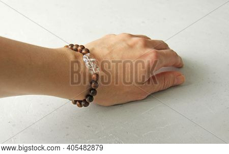 Bracelet Made Of Wooden Beads On A Woman's Hand, Bracelet Made Of Natural Stones, Natural Rhinestone