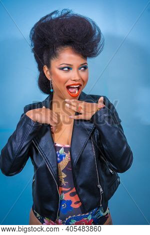 A Closeup Portrait Of A Sexy Attractive Rocker Style Woman In A Bodysuit Undressing Her Leather Jack