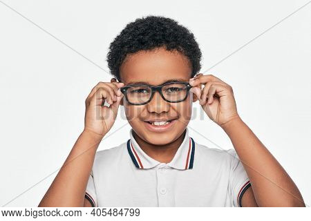 African American Little Boy Adjusting Stylish Eyeglasses, Looking At Camera, Isolated On White Backg