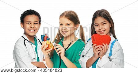 Group Of Positive Multiethnic Kids Wearing Medical Uniforms And Stethoscopes. Medical Healthcare And