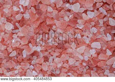 Close Up Background Texture Of Small Fine Ground Crystals Pink Himalayan Salt, Elevated Top View, Di