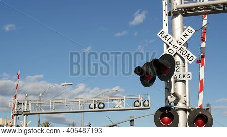 Level Crossing Warning Signal In Usa. Crossbuck Notice And Red Traffic Light On Rail Road Intersecti