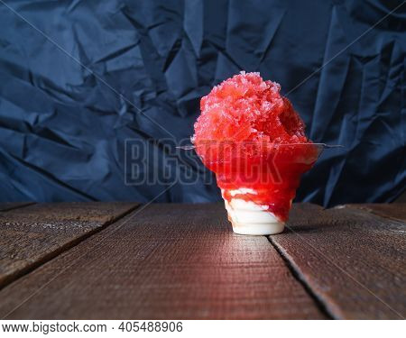 Red Hawaiian Shaved Ice, Shave Ice Or Snow Cone With Ice Cream On The Bottom In A Clear Cup.