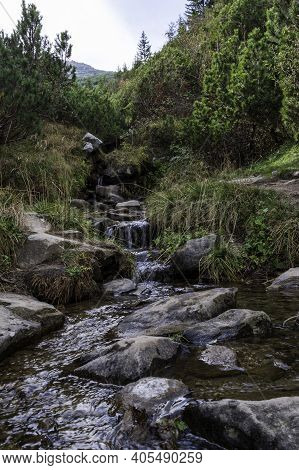 Mountain River. Drinking Water In The Mountains. Water Supply In Nature. Vertical Frame.