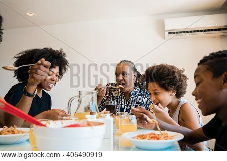 Portrait Of African American Family Having Lunch