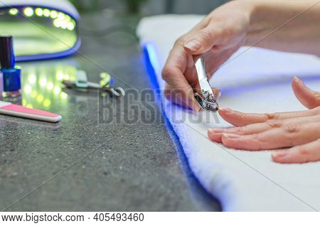 Woman Cutting Nails With Nail Clippers - Close-up. Home Nail Care