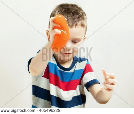 Kid Playing Hand Made Toy Called Slime. Kids Hands Playing Slime Toy. Making Slime. Selective Focus.