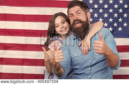 Thumbs Ups For Independence. Father And Little Child Gesturing On Independence Day On American Flag