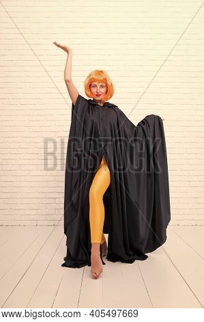 Stop Hiding Bright Energy. Feel Your Body. Dancing Theatre Performer. Girl With Long Fit Legs Orange