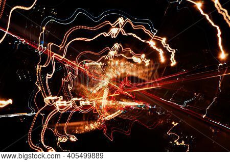 High-speed Multidirectional Light Paths Of City Lights And Car Headlights On The Road, Highway In Th