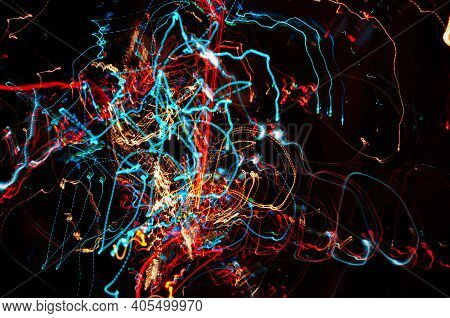 High-speed Swirling Light Traces Of City Lights And Car Headlights On The Road, Highway In The Night