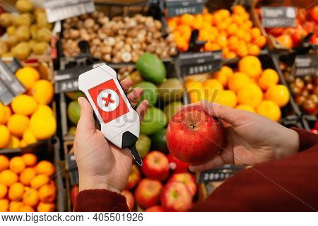 Use Nitrate Tester With Apple. Make Purchases In Supermarket With Device That Checks For Harmful Imp